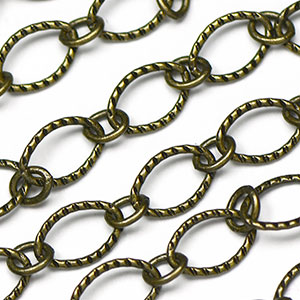 Antique Brass Plated 6x9mm Textured Flat Oval 1-to-1 Cable Chain sold by the foot
