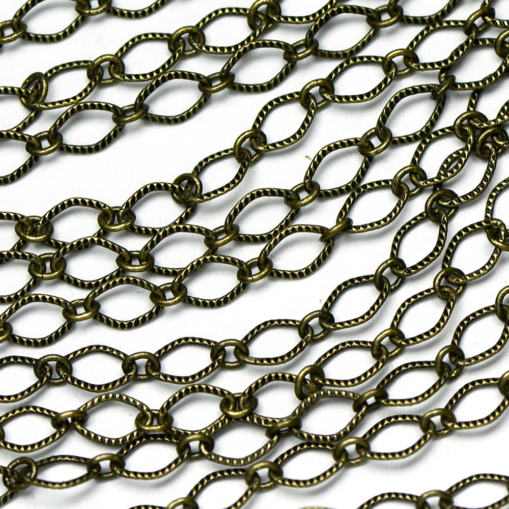 Antique Brass 5.5x4mm Textured Rounded Diamond 1-and-1 Chain sold by the foot