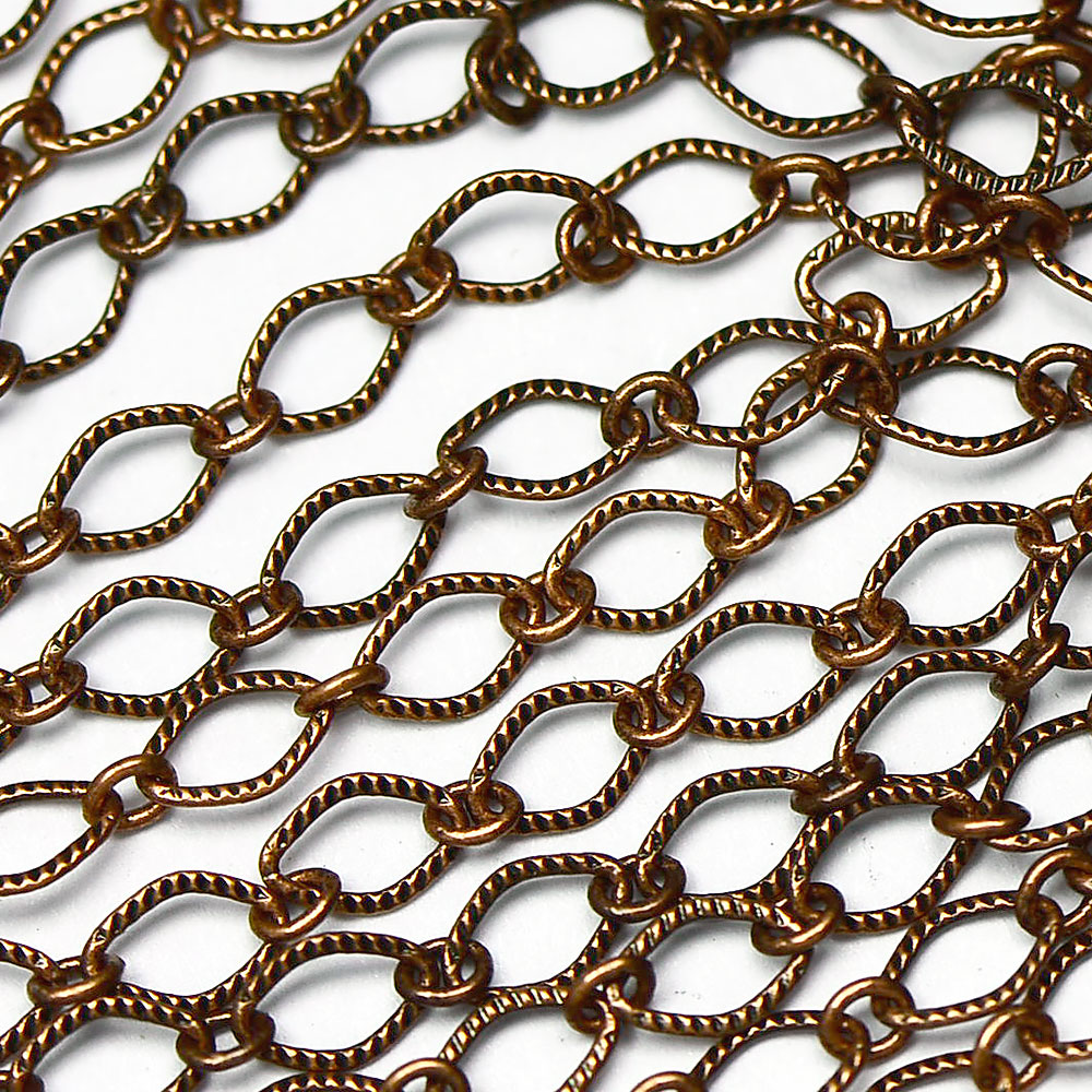 Antique Copper 5.5x4mm Textured Rounded Diamond 1-and-1 Chain sold by the foot