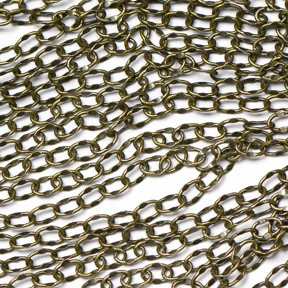 Antique Brass 4x2mm Delicate Dapped Cable Chain sold by the foot